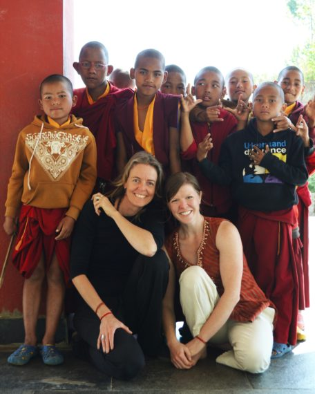 Annie Seymour and Sam Voolstra with monks during yoga retreat in Nepal